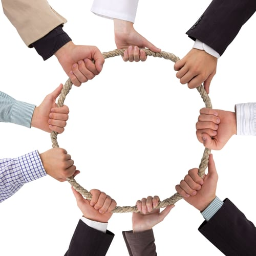Hands holding rope forming a circle with white space for text